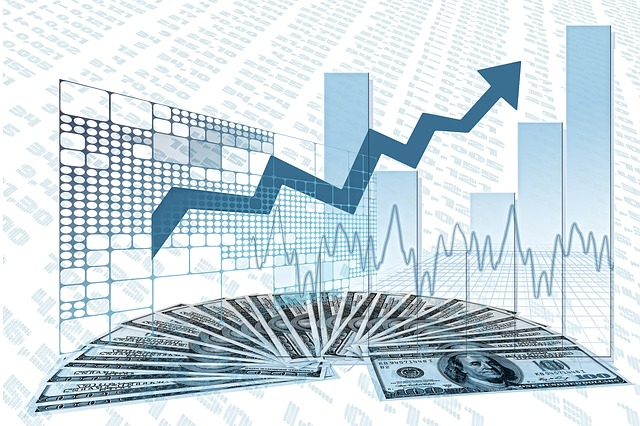 Bar graph with an upward arrow, placed on top of $100 bills.