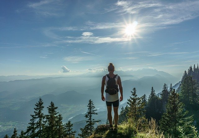 Hiker standing at the top of a mountain.
