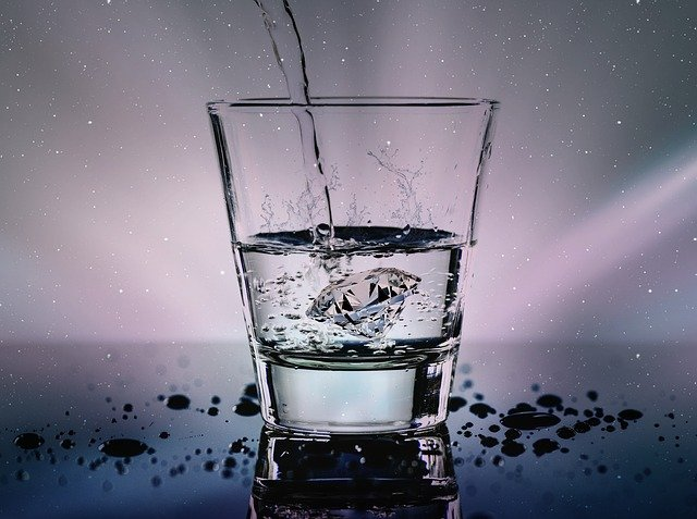 Water being poured into a glass.